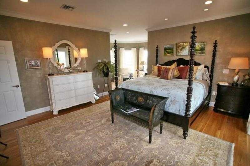 The master bedroom also features a seating space and walk-in closet.