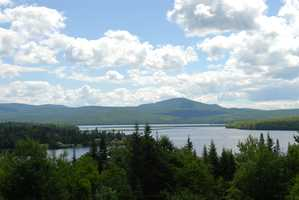 Located on the property at Lopstick Lodge and Cabins, Osprey is the last in a line of cabins overlooking the resort's trout pond, with a magnificent view of the big lake and Mount Magalloway.