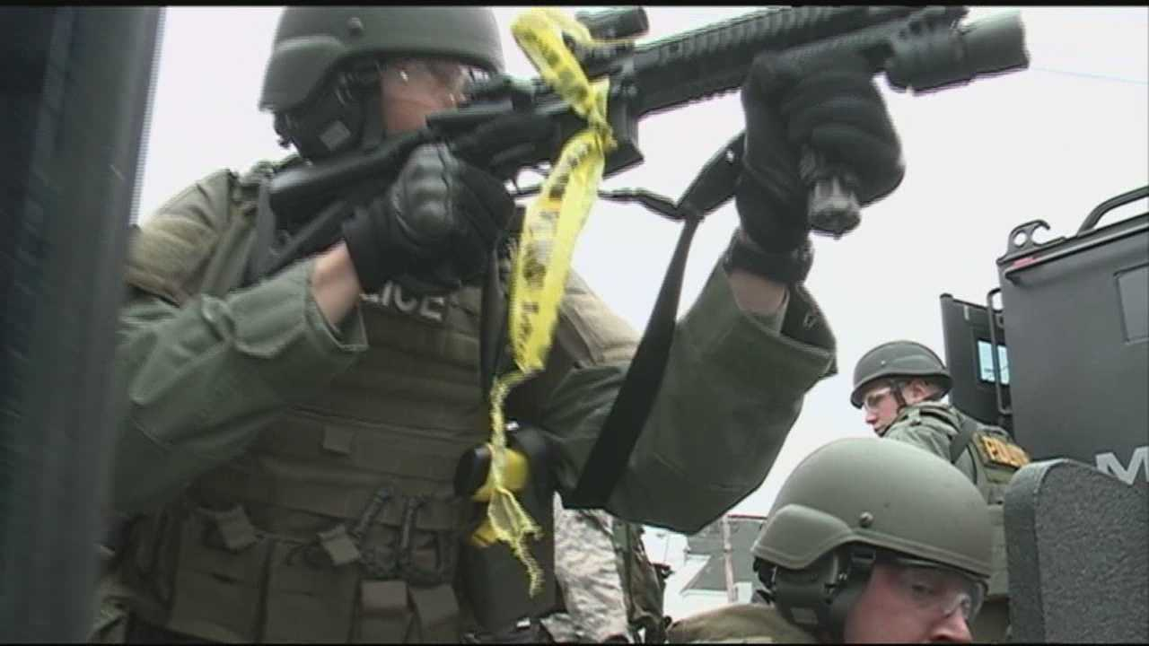 SWAT teams are police officers who put themselves in the direct line of fire, entering buildings where armed suspects may be hiding.