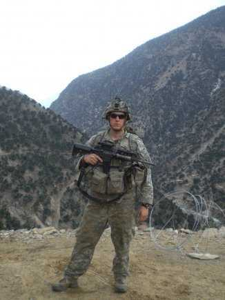 Sgt. Ryan Pitts, with Chosen Company, takes a break from building a traffic control point northeast of Combat Outpost Bella, Afghanistan, spring 2008. The traffic control point was on the road from COP Bella to Aranas, Afghanistan.