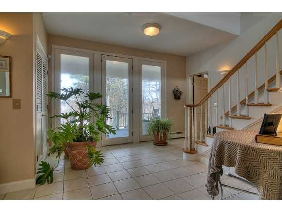 Inside, the home features cathedral ceilings and lots of windows and skylights to let in sunshine.