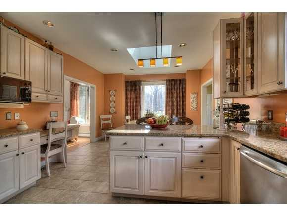 A kitchen with a dining area...
