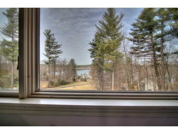 The property has a view of Cobbetts Pond and the surrounding landscape.