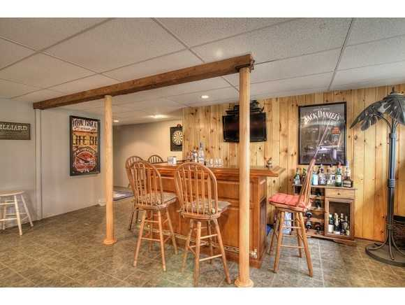 The property also includes a finished basement with a bar and room for activities.