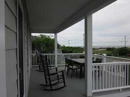 Located on Ocean Boulevard just north of the intersection with Washington Road, this lovely oceanfront home has a large outdoor porch to take in the view and the sound of the crashing surf.