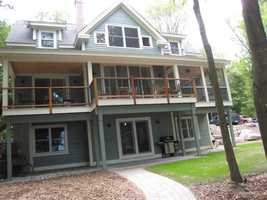 The house has several decks and a screened-in porch.