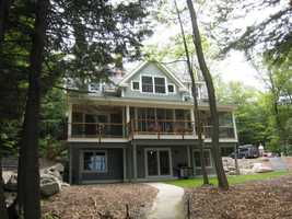 Set with an expansive view of Lake Sunapee and a large dock and cabana this Summer Spot has it all for a group of 10.