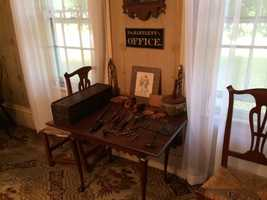 His medical instruments are displayed in the parlor.