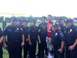 Quarterback Tom Brady posed for pictures with police officers after.