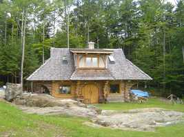 The property also includes a caretaker cottage with a private bedroom, bathroom, kitchen and living area.