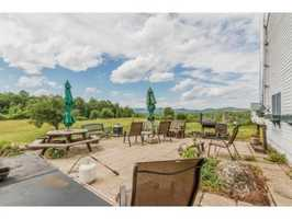 The property features expansive views of Lovewell Mountain and the surrounding landscape.
