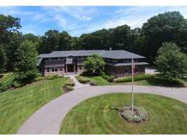 The 10,463 square-foot home is situated on more than 5 acres of land on Patriots Road.