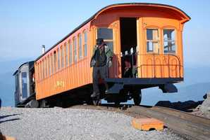 Take a scenic tour of Mount Washington and the surrounding landscape on the Cog Railway.