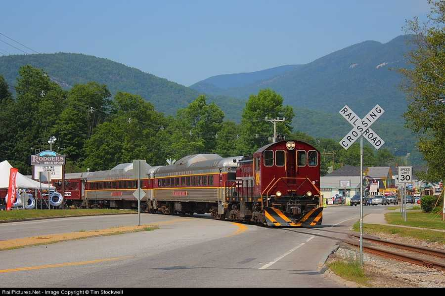 The Hobo Railroad's scenic train ride crossing the Kancamagus Highway in Lincoln, NH during its one hour and twenty minute round trip excursion along the winding Pemigewasset River to Woodstock, NH before it returns to Lincoln.