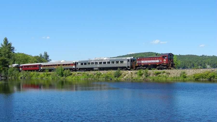 The Winnipesaukee Scenic Railroad's scenic train ride is shown passing Maiden Cove along Lake Winnipesaukee during its 2-hour round trip excursion between Meredith and Lakeport, NH and back.