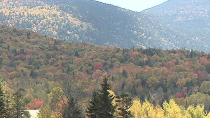 Tourists flock to Waterville Valley to admire fall foliage.