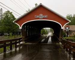 Mechanic Street Bridge in Lancaster, N.H.Constructed in 1862. This bridge is also known as the Israels River Bridge. Shortly after it was built, the town people voted to put a sign on each end that prohibited driving across the bridge at a speed faster than a walk.