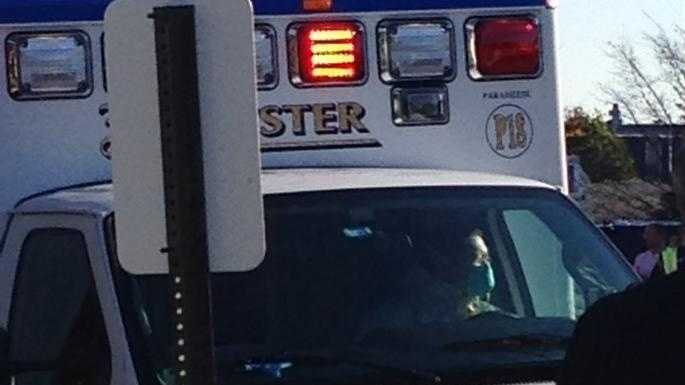 The driver of an ambulance carrying a man with Ebola-like systems is wearing a face mask and hazmat suit.