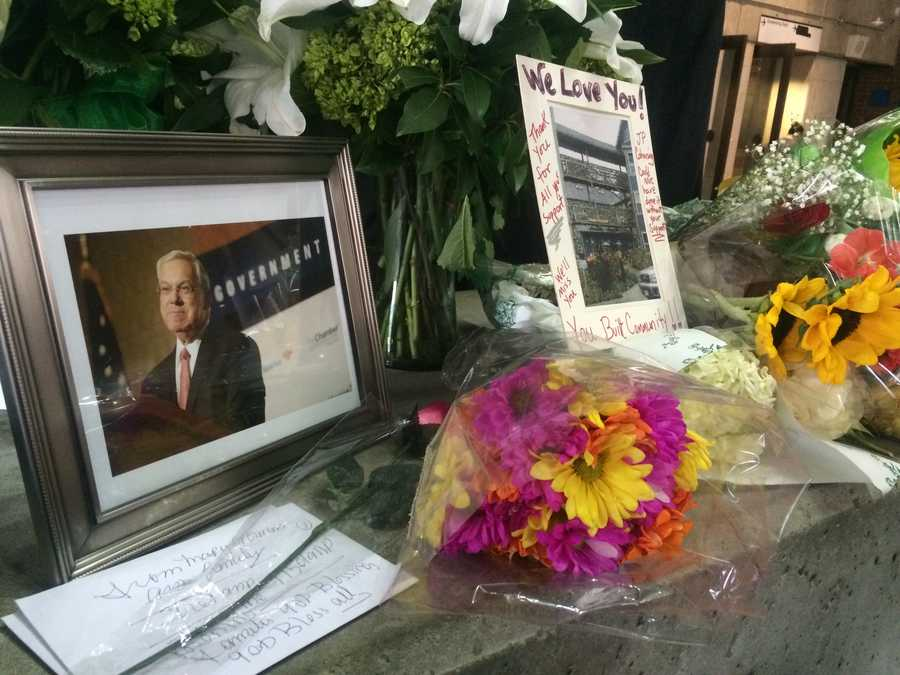 Flowers and a picture of Menino as condolences are offered at City Hall