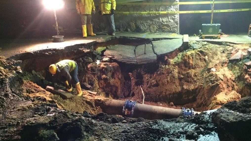Work continues to repair broken 16 inch water main on Goffe Street in Manchester.
