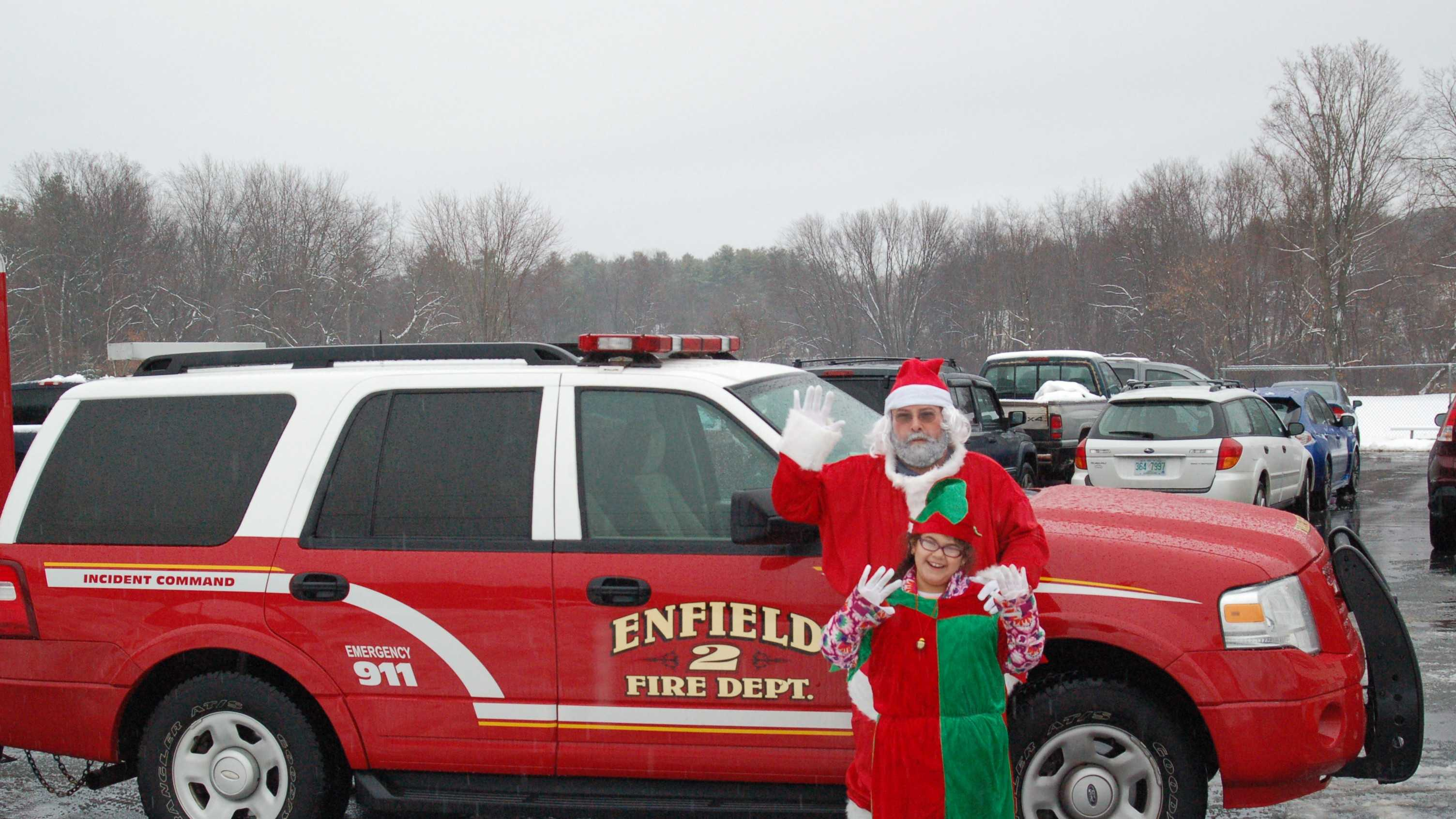 Residents donate to the Holiday Food and Toy Drive in Enfield this weekend.