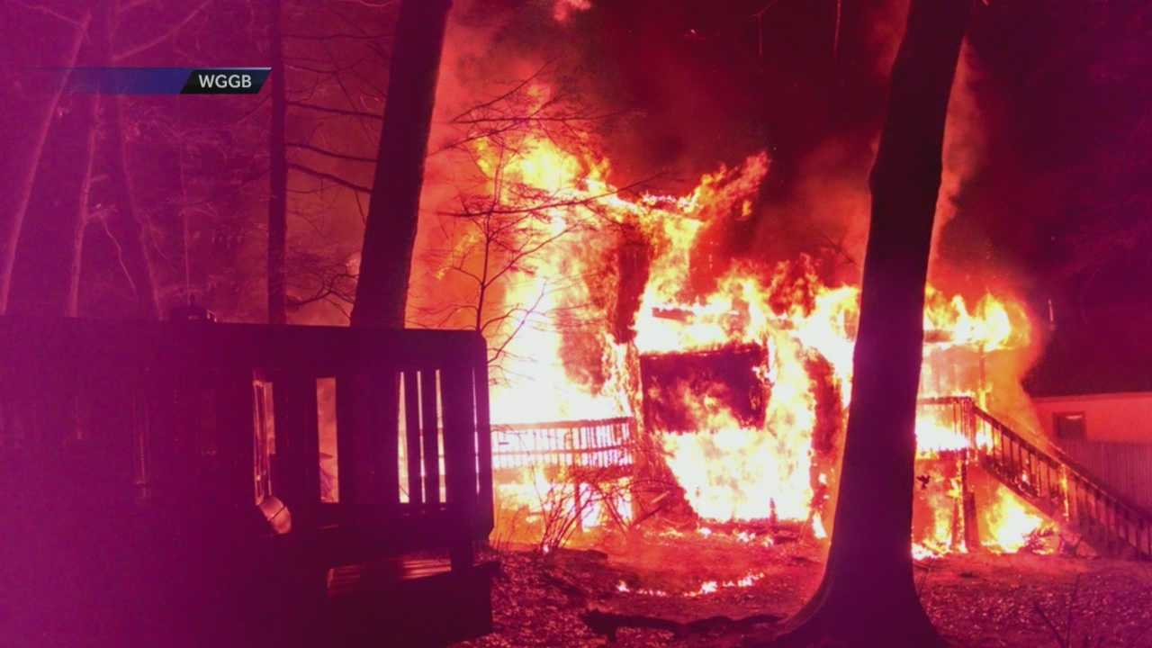 A mother rushed back into her burning home to rescue her infant child on Christmas Eve in Southwick.
