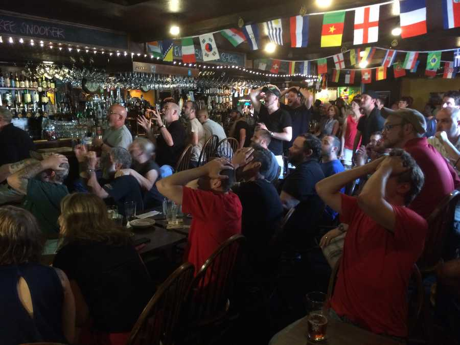 Fans at the Coat of Arms Pub in Portsmouth react to a near-miss by Team USA during the World Cup.