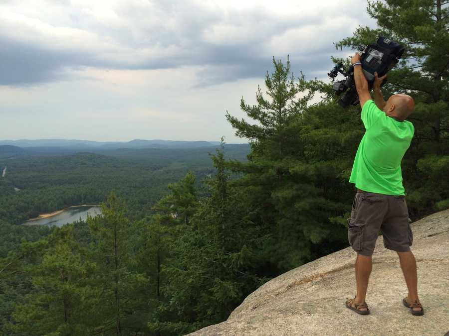 WMUR Photographer Jim Lord shooting video at Cathedral Ledge in North Conway.