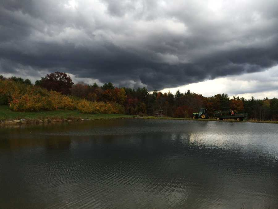 Storm clouds gather over Apple Hill Farm in Concord.