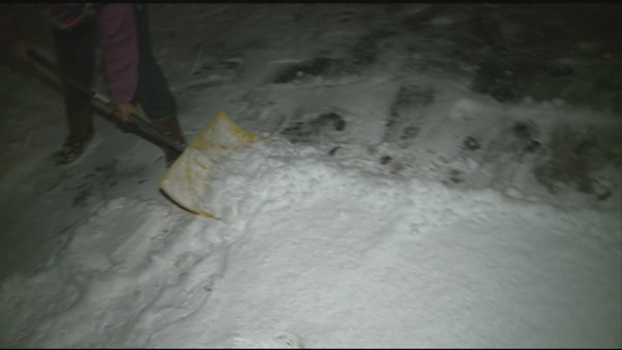 Granite Staters shovel the snowy mess Saturday evening.