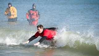 News 9 Meteorologist Kevin Skarupa dives into the Atlantic Ocean for the 16th Annual Penguin Plunge Sunday.