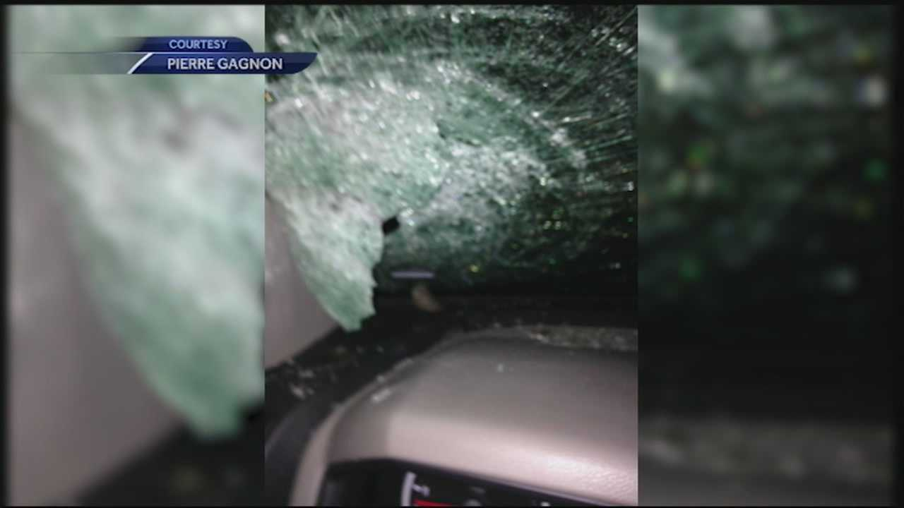 A chunk of ice crashed through the windshield of a Bow man driving to work Monday morning after a snow plow pushed the ice off an overpass.