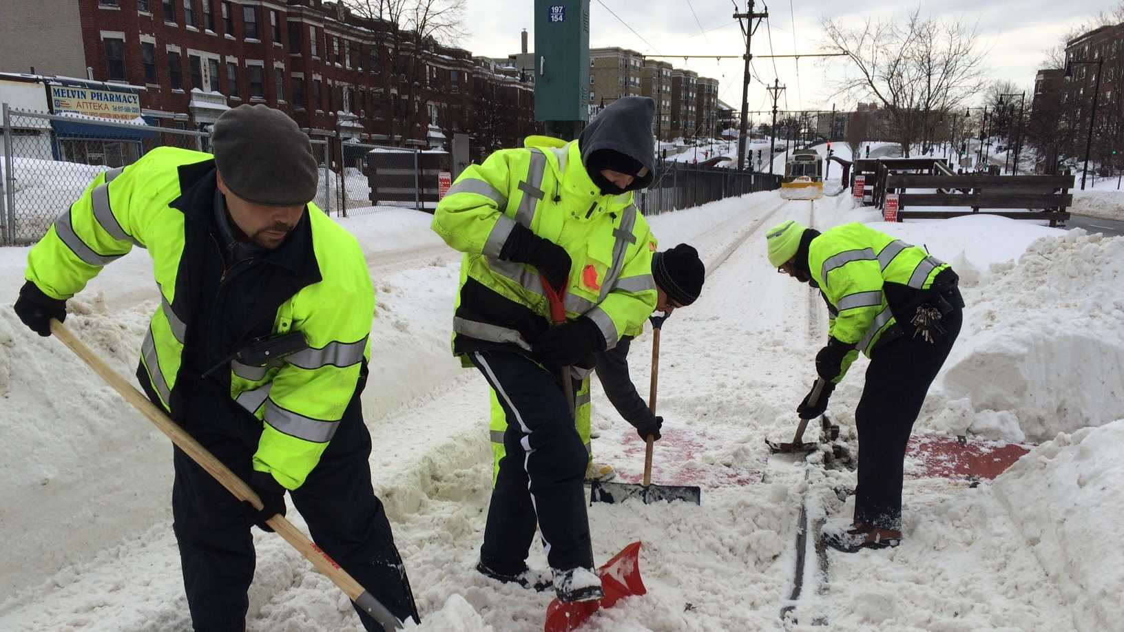 MBTA employees shovel out Green Line Tracks in Brighton on Tuesday, Feb. 10., 2015.