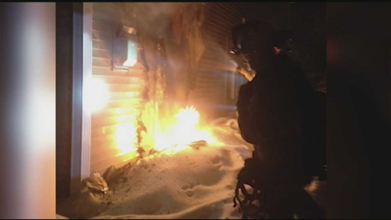 A police officer is being called a hero for helping a disabled man get out of a Portsmouth condominium that was on fire as firefighters reached into the flames to stop a propane leak.