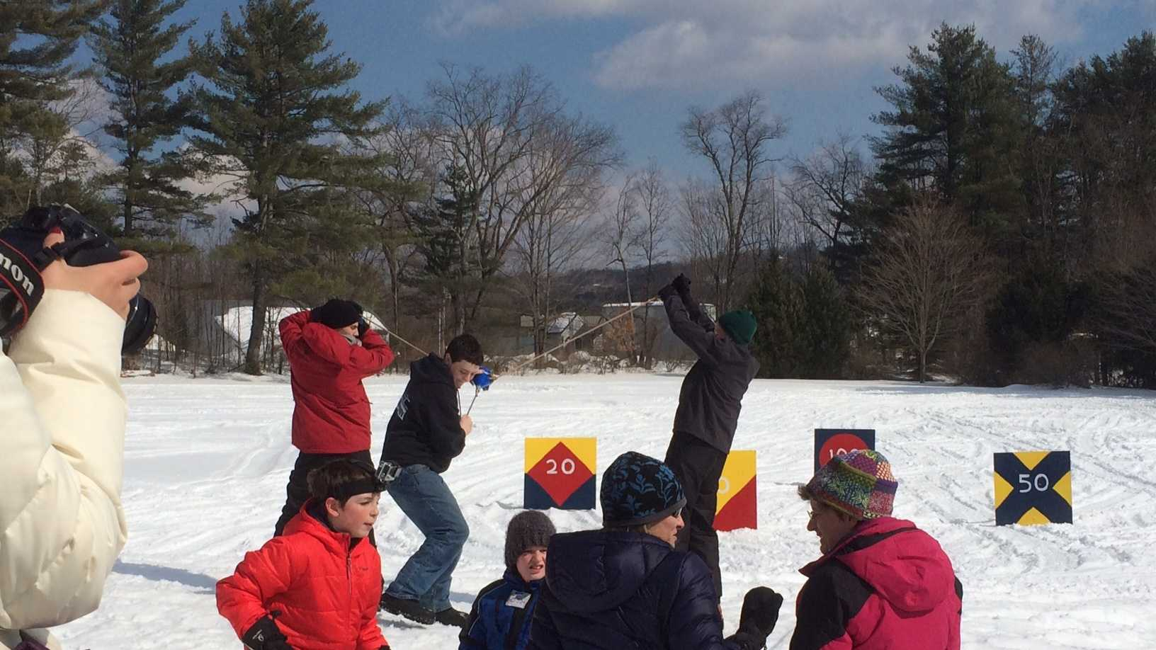 Winter adventurers launched snowballs with a slingshot in the third annual Funnelator Winter Festival Sunday.