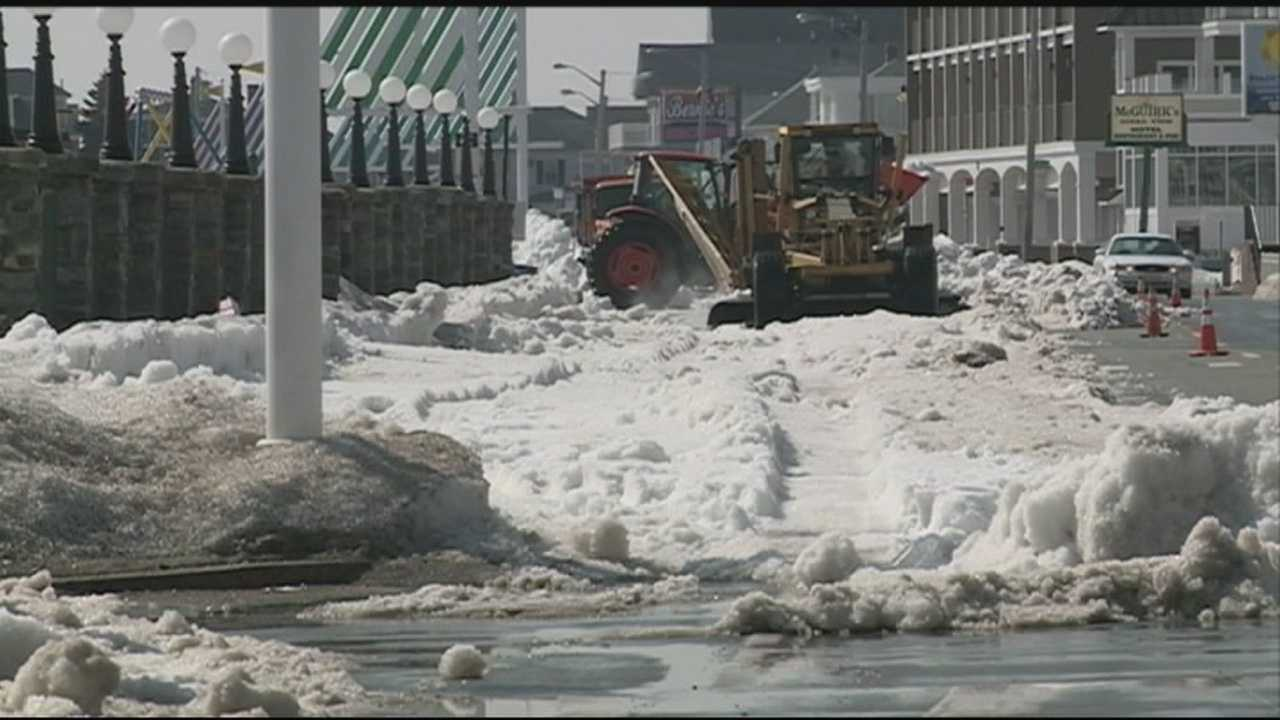 State and town crews Thursday hauled away much of the snow remaining in Hampton Beach after a harsh winter.