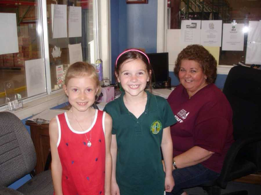 Carolina and Elsa: at NHFB. Thier first visit to the old food bank to drop off food for their annual birthday drop-off. 2009