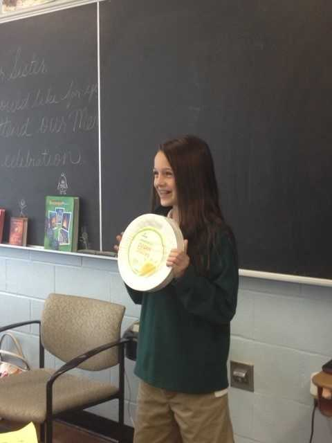 Elsa does presentation to 6th grade class for HAM. Her 6th grade class agreed to take a stand against hunger by showing their concern with plates to display at the NHFB. Dec. 2013