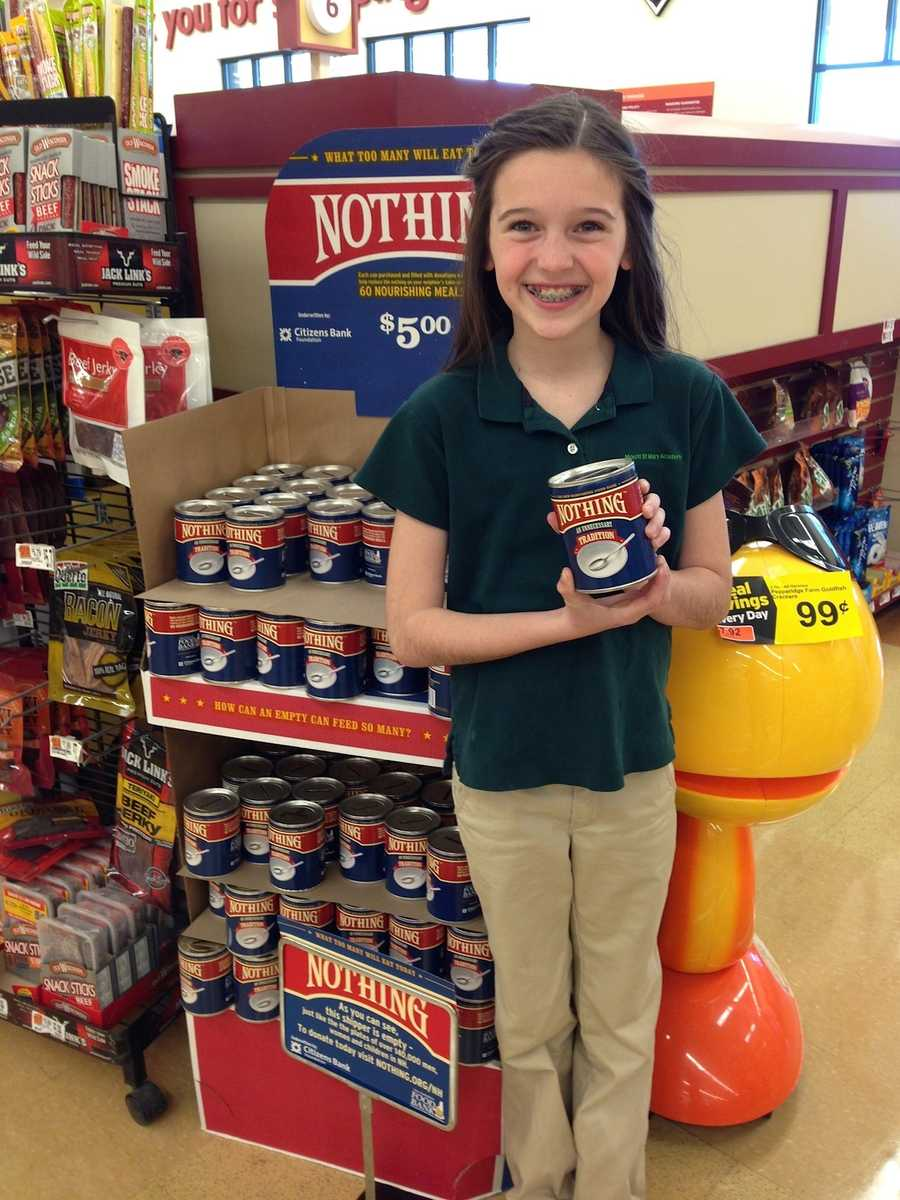 Elsa purchases a can to support the 2014 Nothing Campaign.