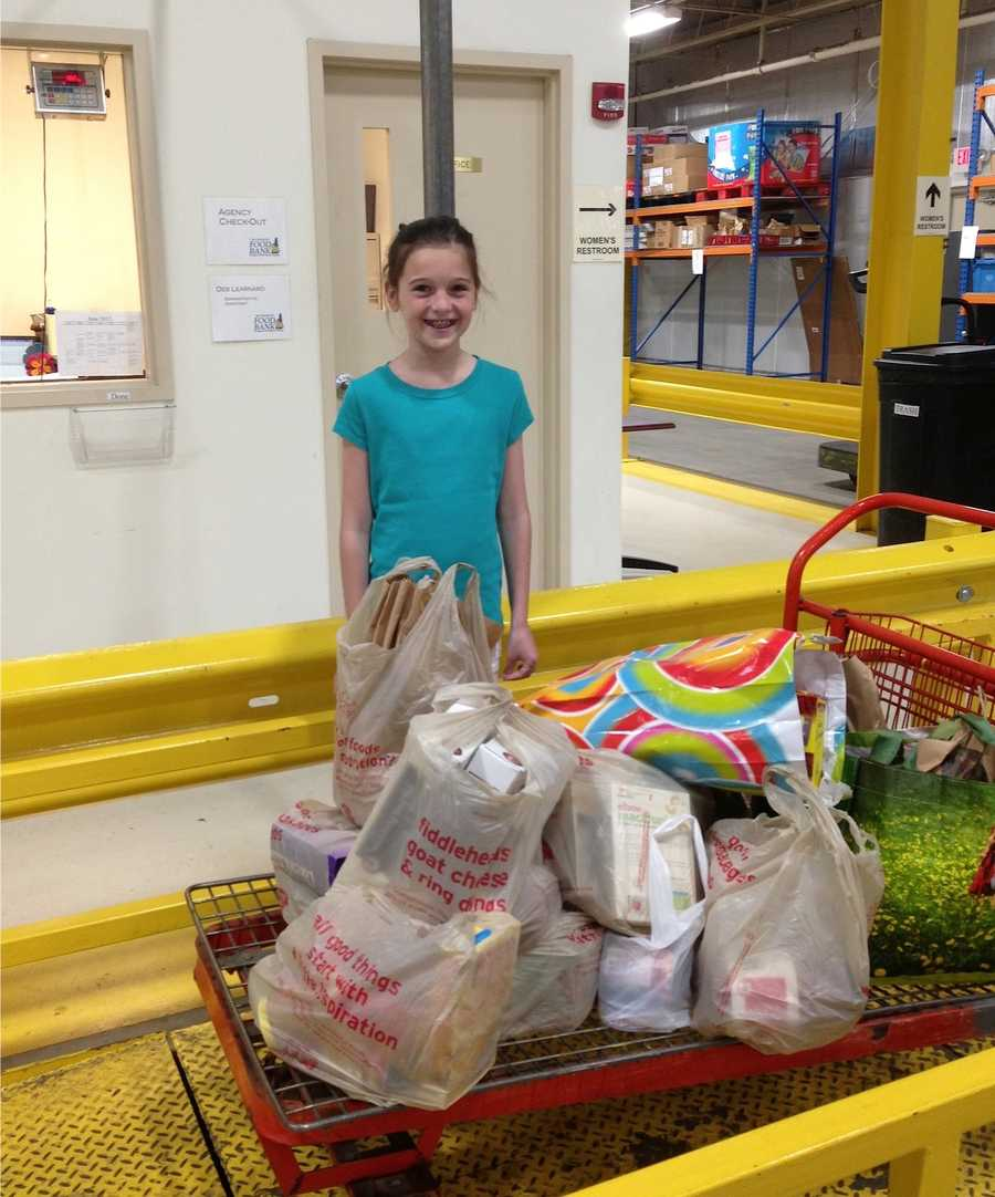 Elsa dropping off collected food from her 10th birthday party.