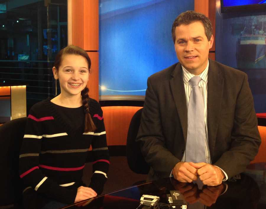 Elsa and Sean at news desk. 2014