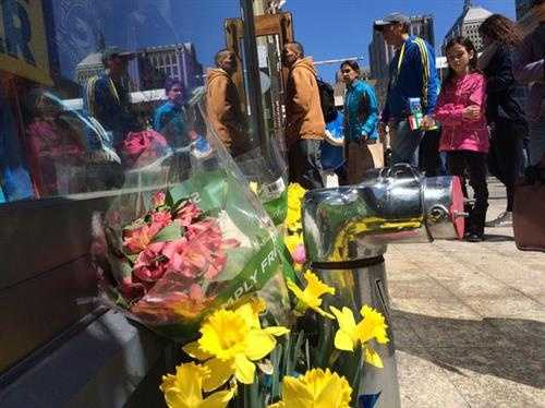 Bombing victim remembered with flowers outside Marathon Sports