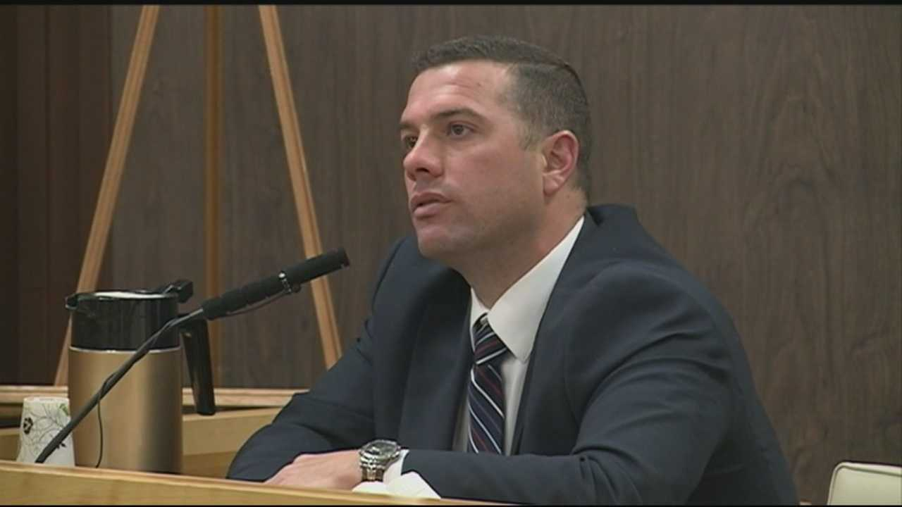 A Portsmouth policeman named in an elderly woman's multimillion-dollar will took the stand in probate court Tuesday, saying he was happy to help her in the years before she died.