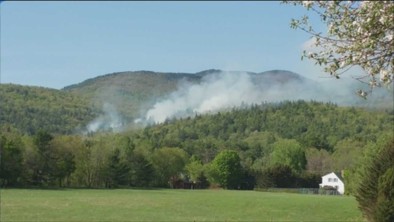 Hot spots remain after firefighters battled a four-alarm brush fire for hours  in Rumney Sunday.