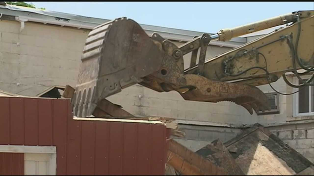 An excavator operator is recovering after the construction equipment crashed through the ground into a basement in Portsmouth.