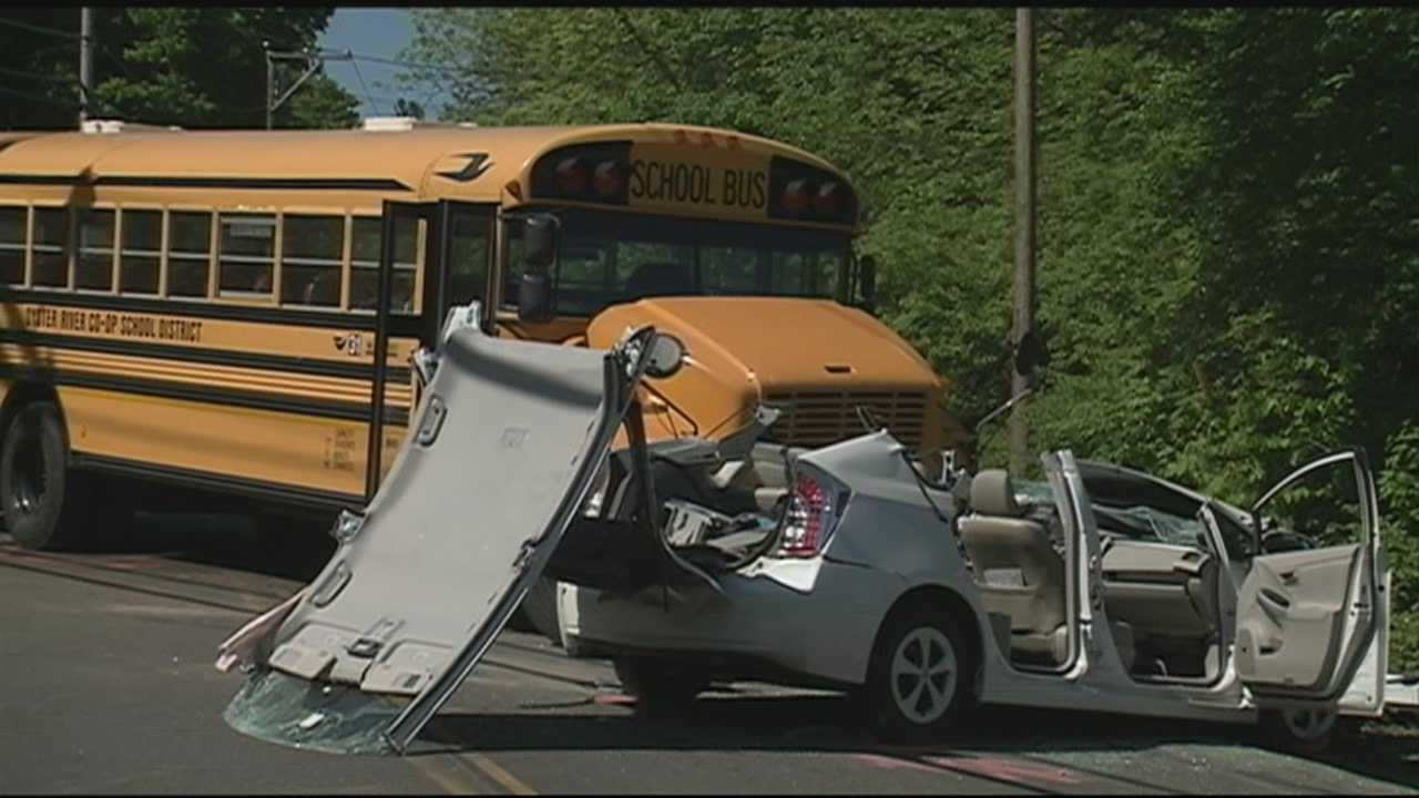 A driver was taken to a hospital Friday after her car collided with a school bus in Durham.