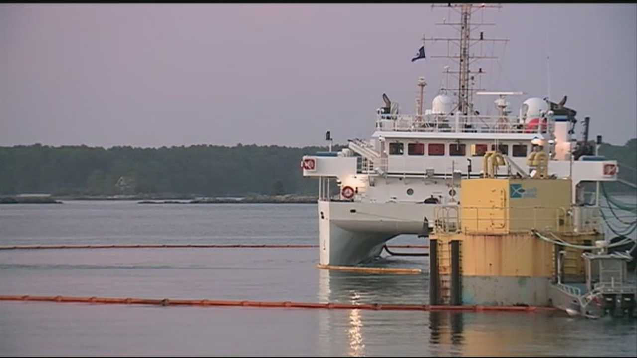 Crews were working Wednesday to clean up an estimated 200 gallons of oily water that were discharged into the Piscataqua River.