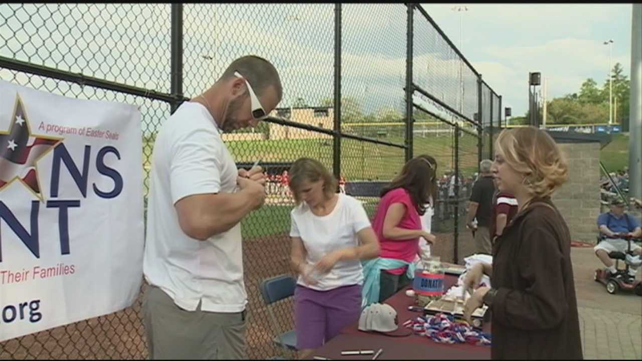 A large crowd turned out for a benefit baseball game in memory of Derryfield School alumnus and Navy SEAL Blake Marston in Manchester Thursday night.