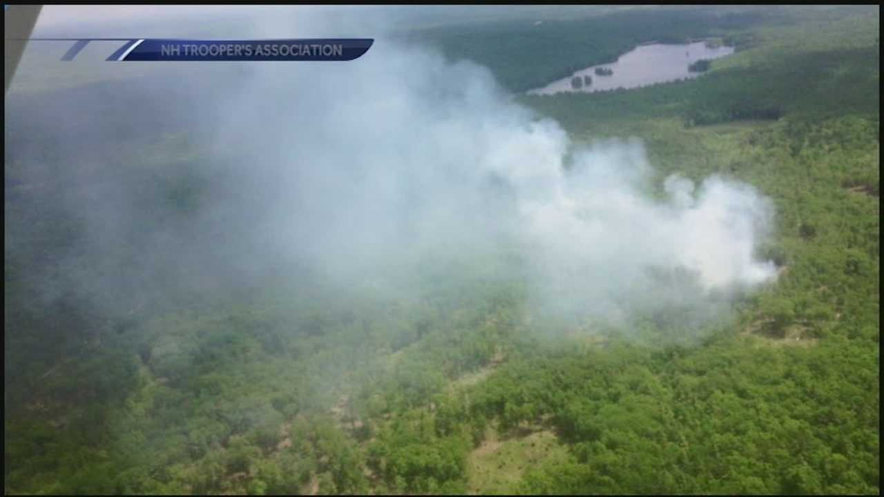 Crews in Hooksett were still battling a brush fire off Whitehall Road Saturday, more than 24 hours after they first arrived.