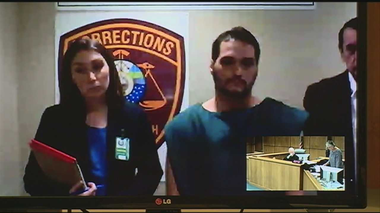 A man accused of killing his parents and setting their house on fire appeared in a New Hampshire court Friday, more than a year after he fled the state.